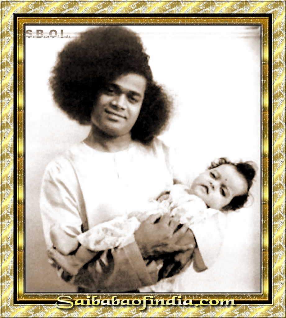 Sathya_Sai_Baba_rare_and_old_photos - Sathya-Sai-Baba-holding-a-baby