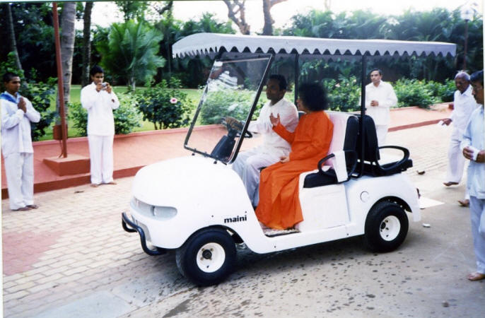 swami in a golf cart darshan