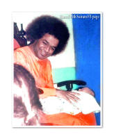 sathya-sai-baba-with-babay-on-his-lap