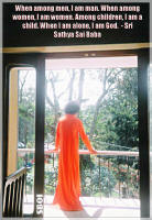 sri-sathya-sai-baba-standing-on-balcony-looking-into-the-woods